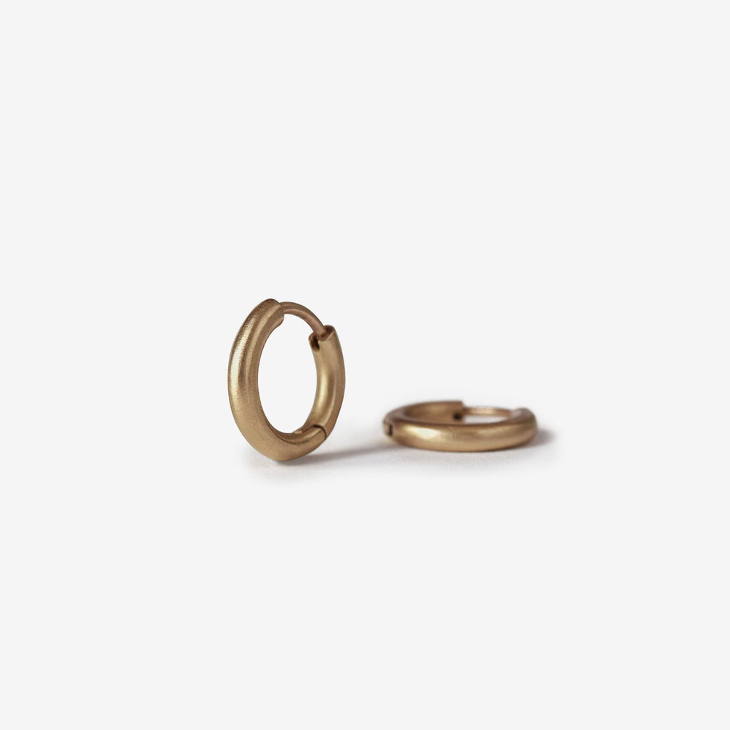 Gold huggie hoops in 14k yellow gold