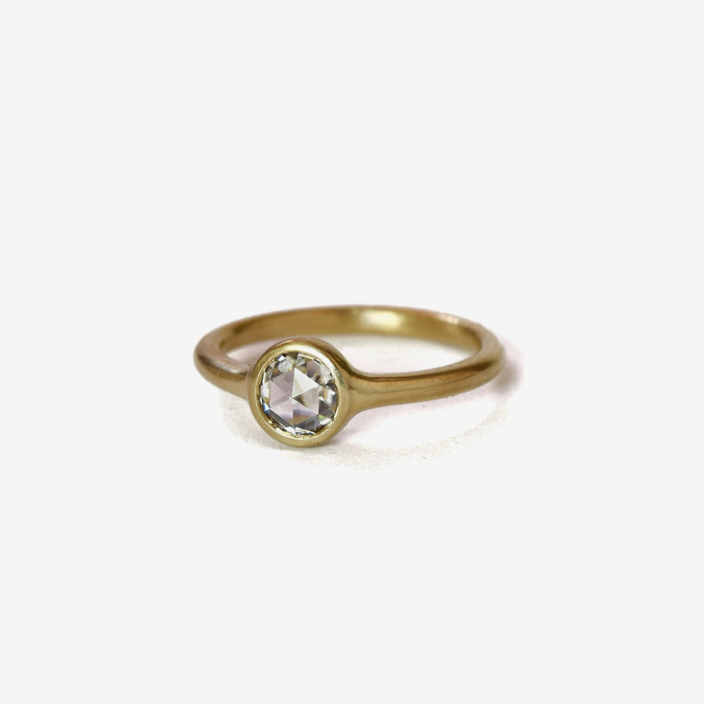 colorless round rose cut diamond ring in 18k gold