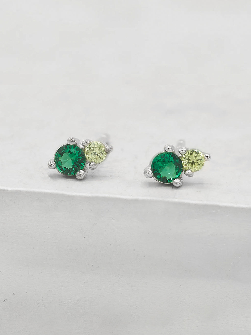 Green Emerald Round Shape Tiny CZ Silver Stud Earrings by The Faint Hearted Jewelry