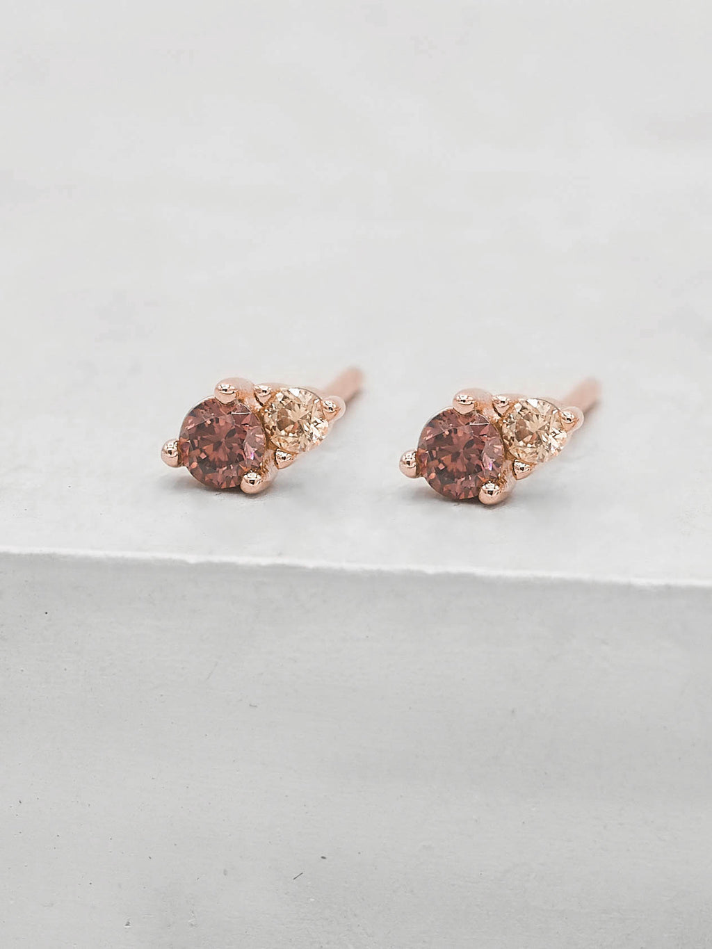 2 Stone Rose Gold Plated Pink Round Shape CZ Stones Stud Earrings by The Faint Hearted Jewelry
