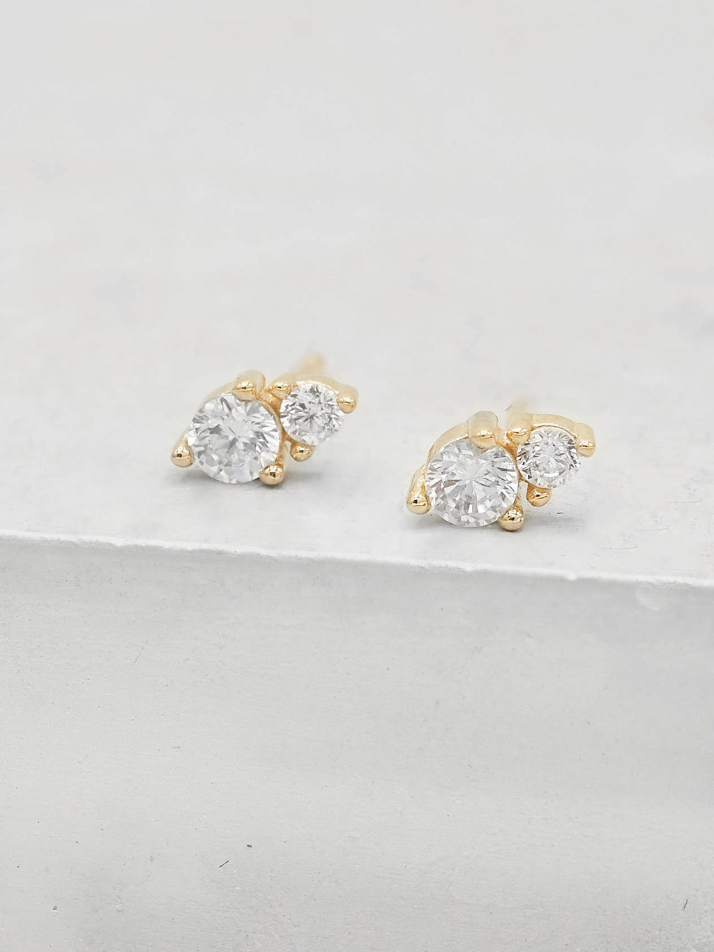 2 stone Round shape CZ Stud Earrings by The Faint Hearted Jewelry