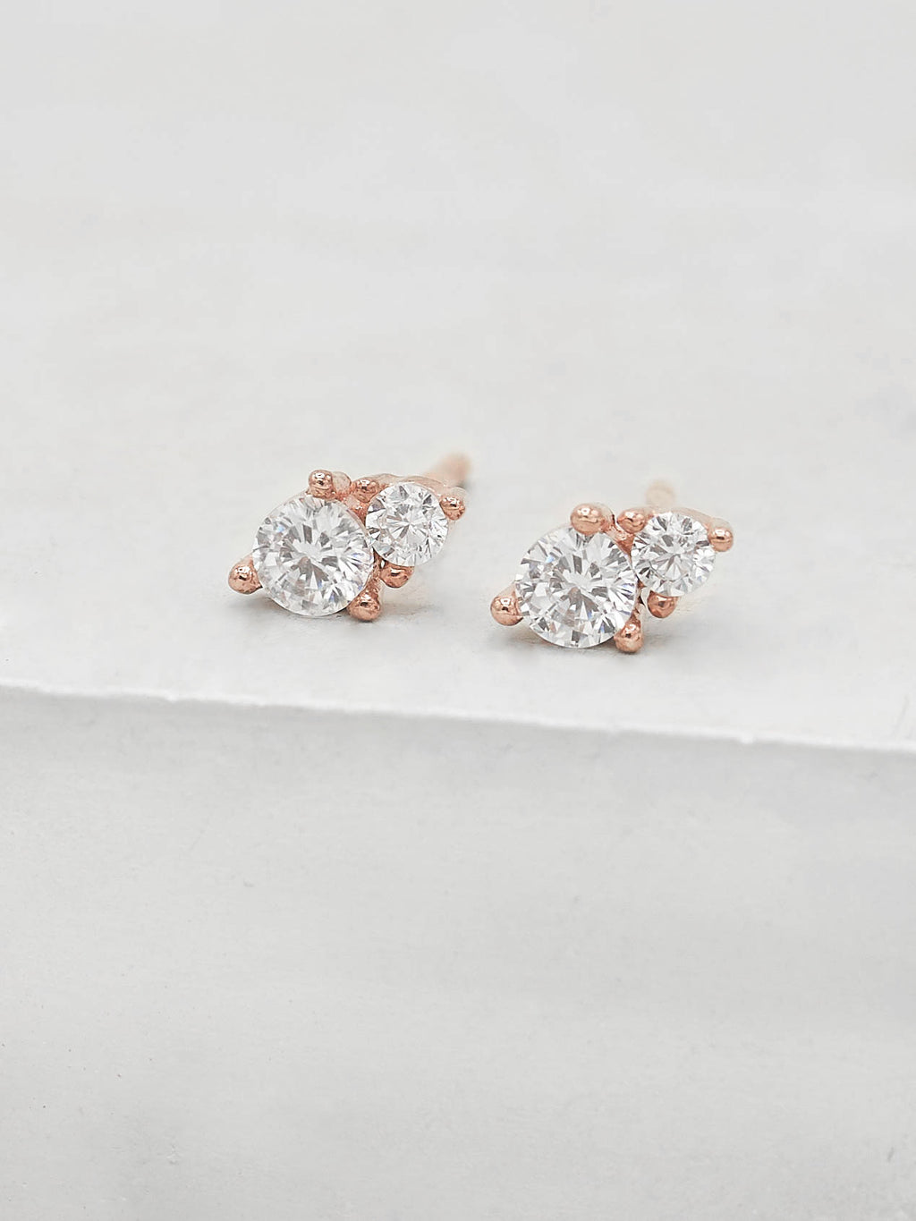 Rose Gold Plated 2 Stone Round Shape White CZ Stud Earrings by The Faint Hearted Jewelry