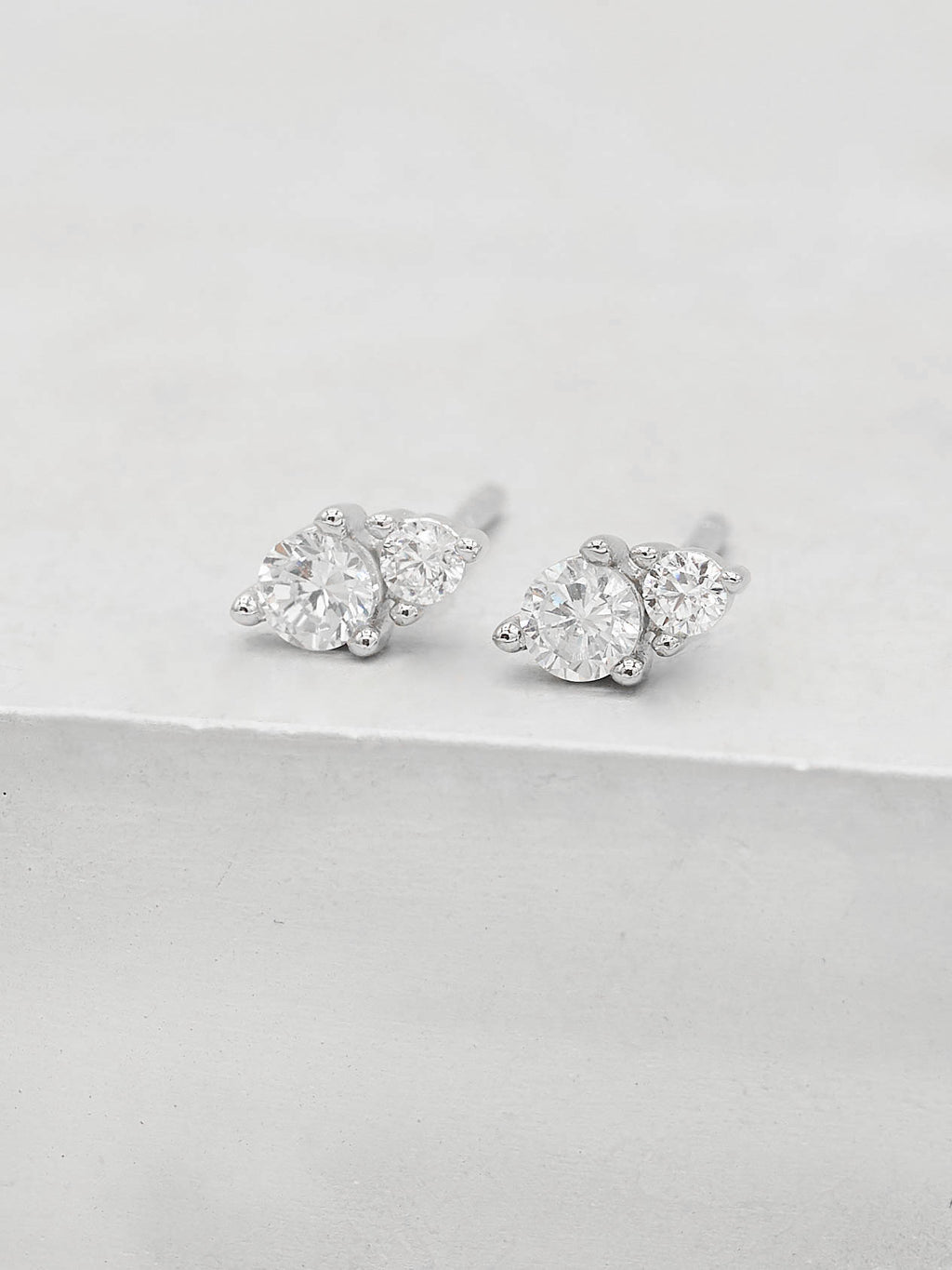2 Stone Round Shape White CZ Silver Stud Earrings by The Faint Hearted Jewelry