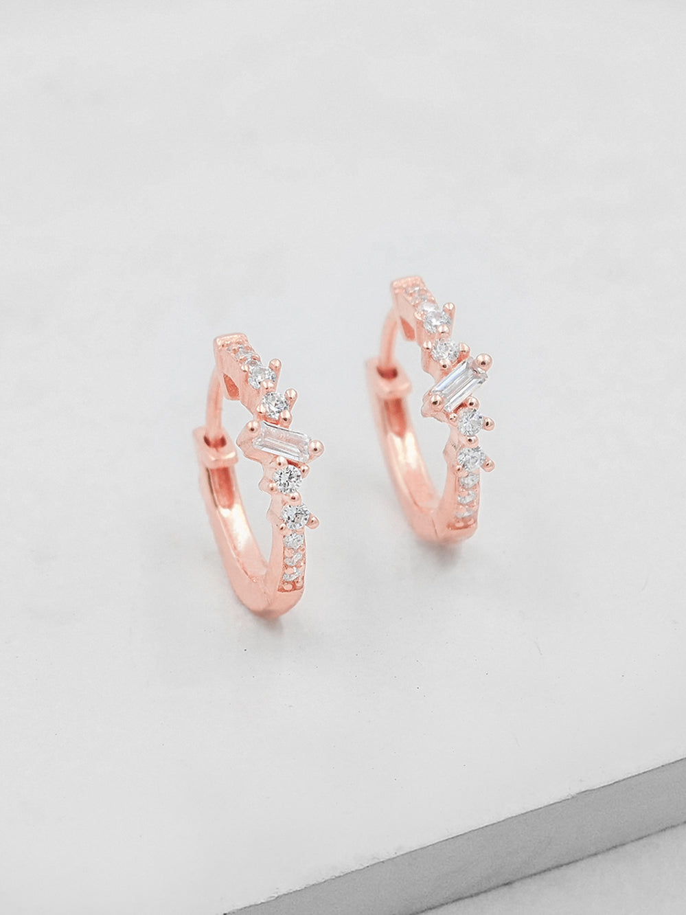 Rose Gold Plated Clusters Baguette and Round CZ Huggies Earrings by The Faint Hearted Jewelry