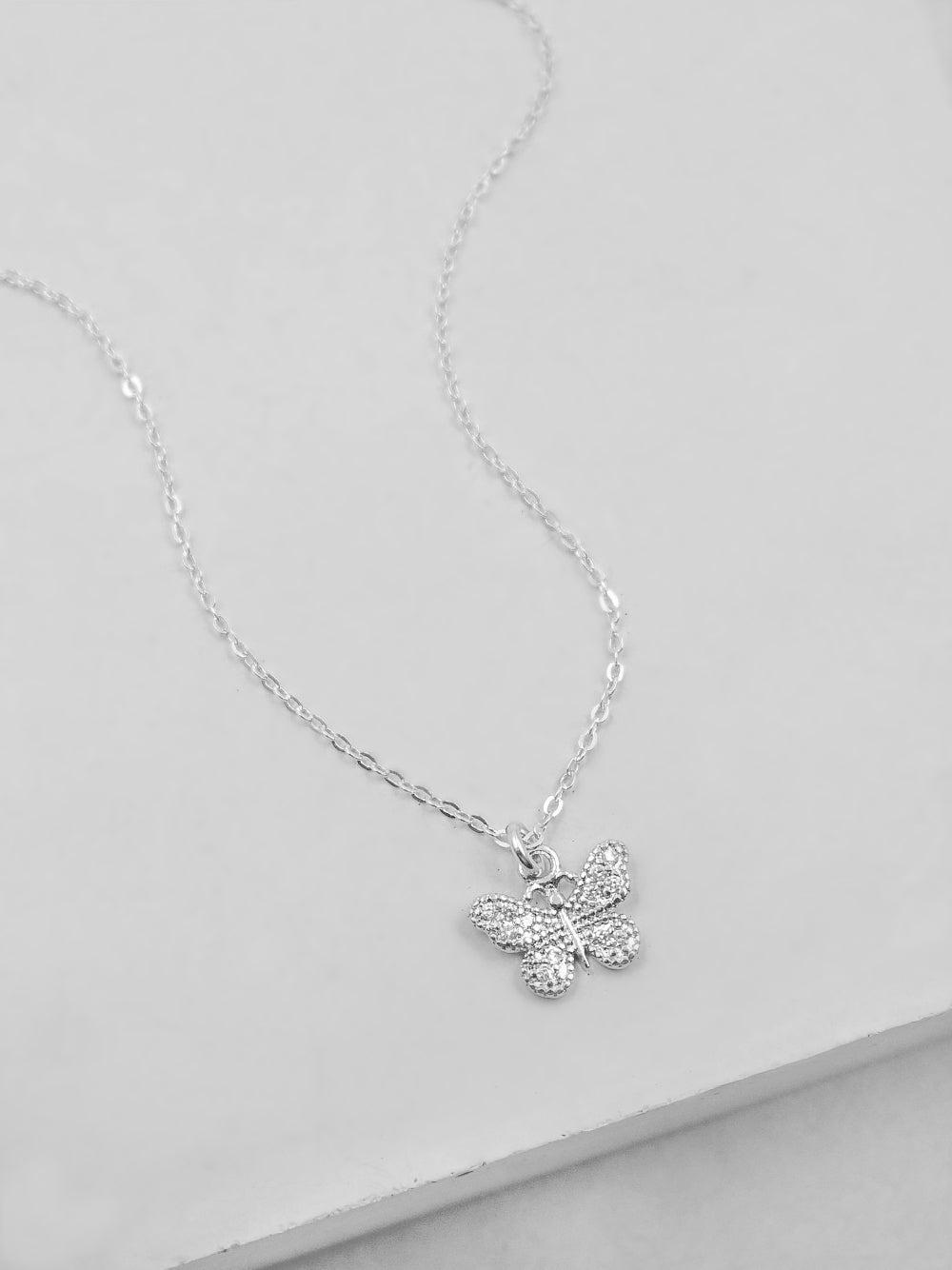 Rhodium Plated Small Butterfly CZ Charm Silver   Necklace by The Faint Hearted Jewelry