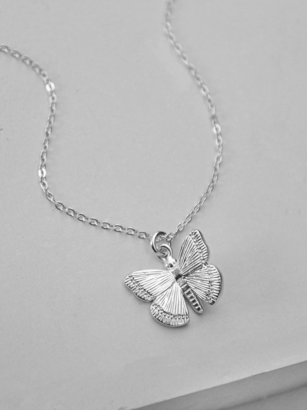 Silver Butterfly Charm  Necklace by The Faint Hearted Jewelry