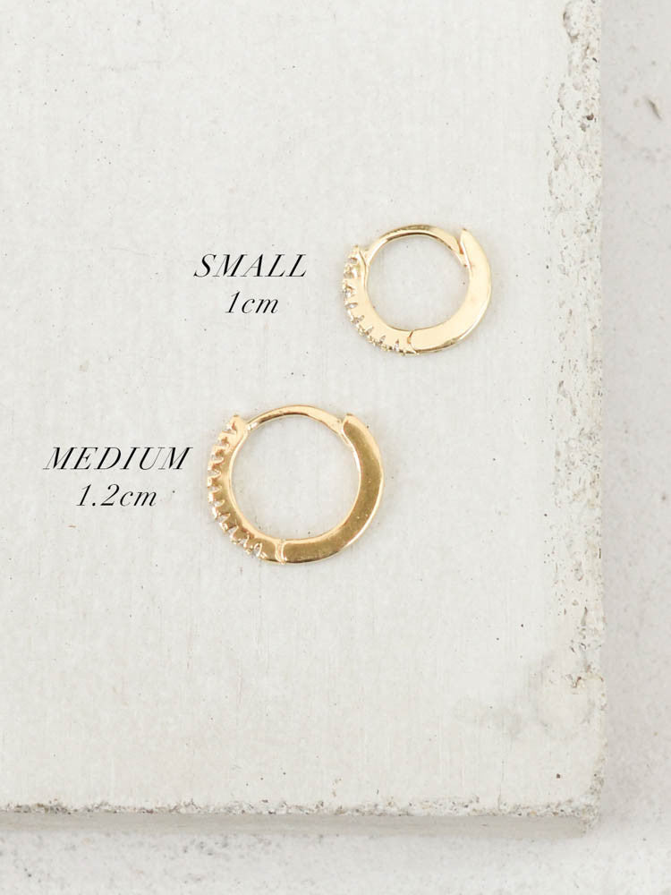 gold mini hoop huggie earrings by the faint hearted jewelry