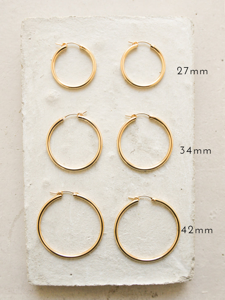 rose gold filled hoop earrings by the faint hearted jewelry