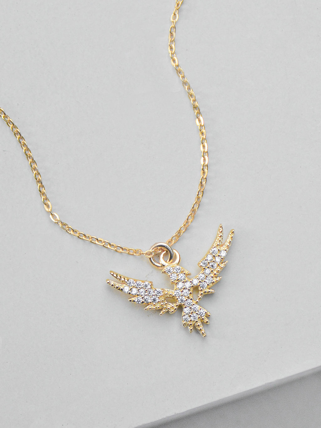 Gold Phoenix Charm Necklace by The Faint Hearted Jewelry