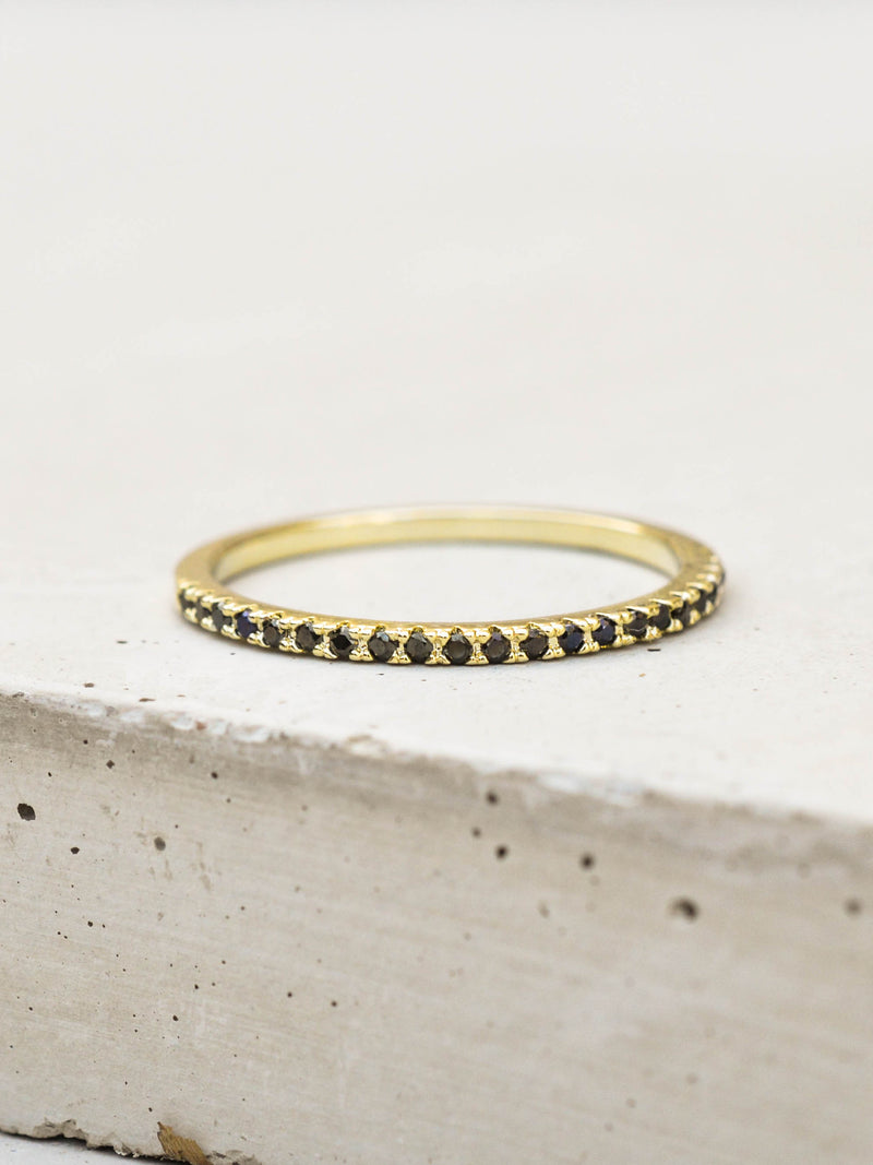 Gold Eternity Band Stacking with Black Stones Ring by The Faint Hearted