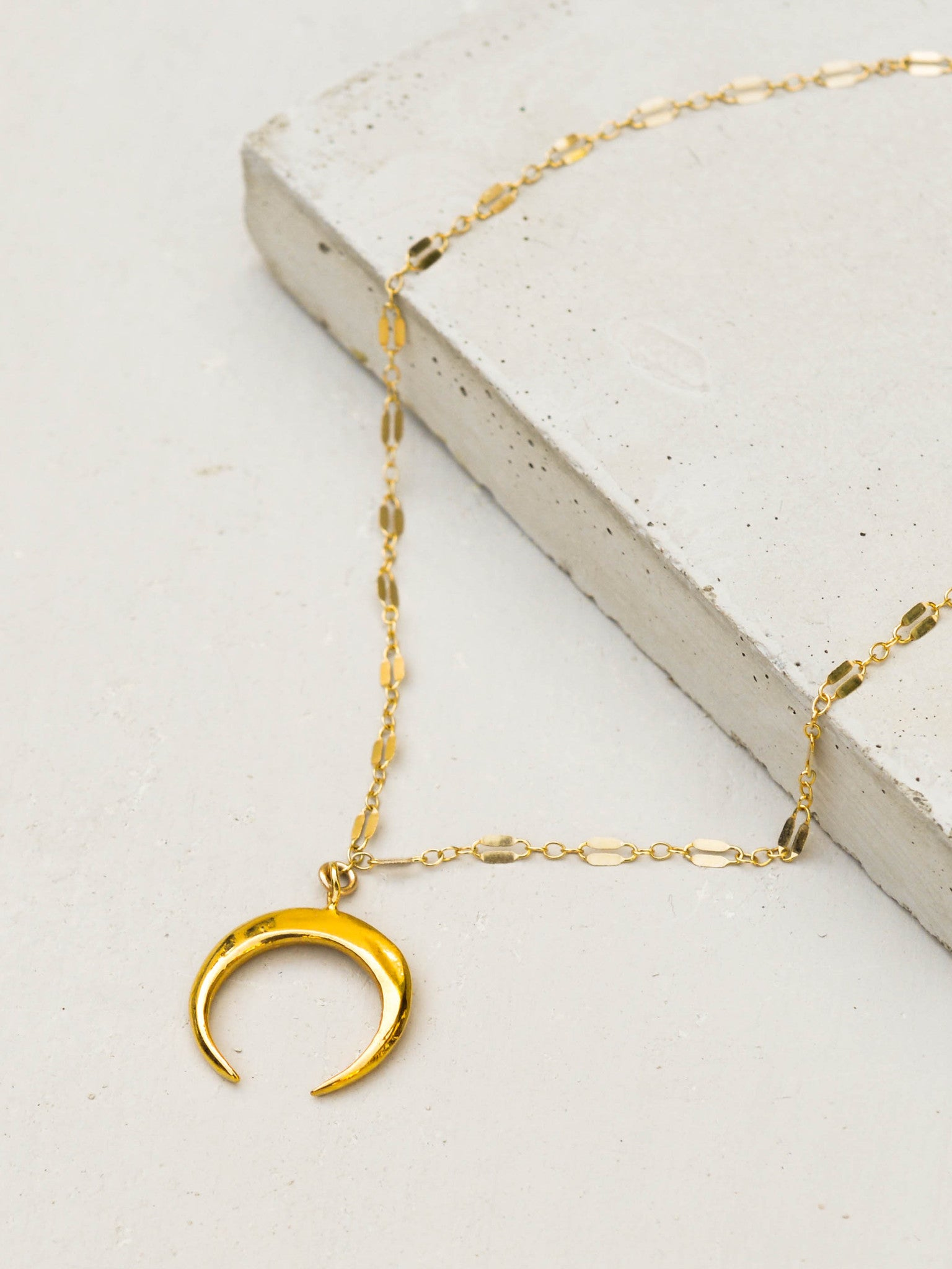 Moon Tusk Dapped Layering Necklace by The Faint Hearted Jewelry