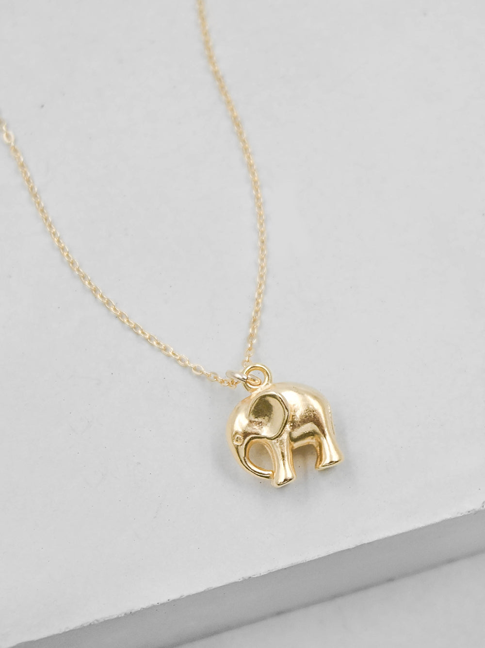 Gold Elephant Charm Necklace by The Faint Hearted Jewelry
