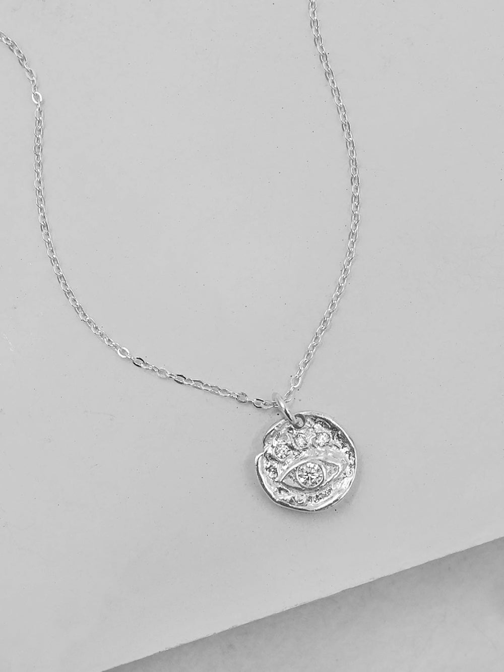 Rhodium Plated Evil Eye Charm Necklace by The Faint Hearted Jewelry