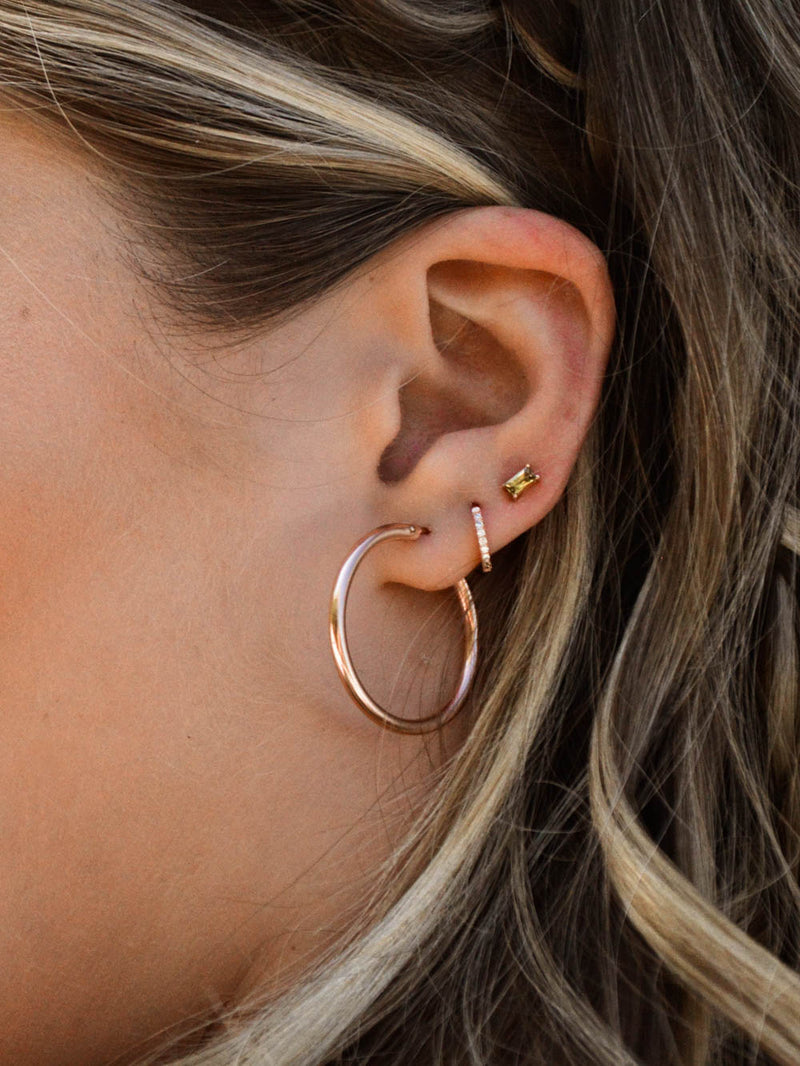 rose gold mini hoop huggie earrings by the faint hearted jewelry