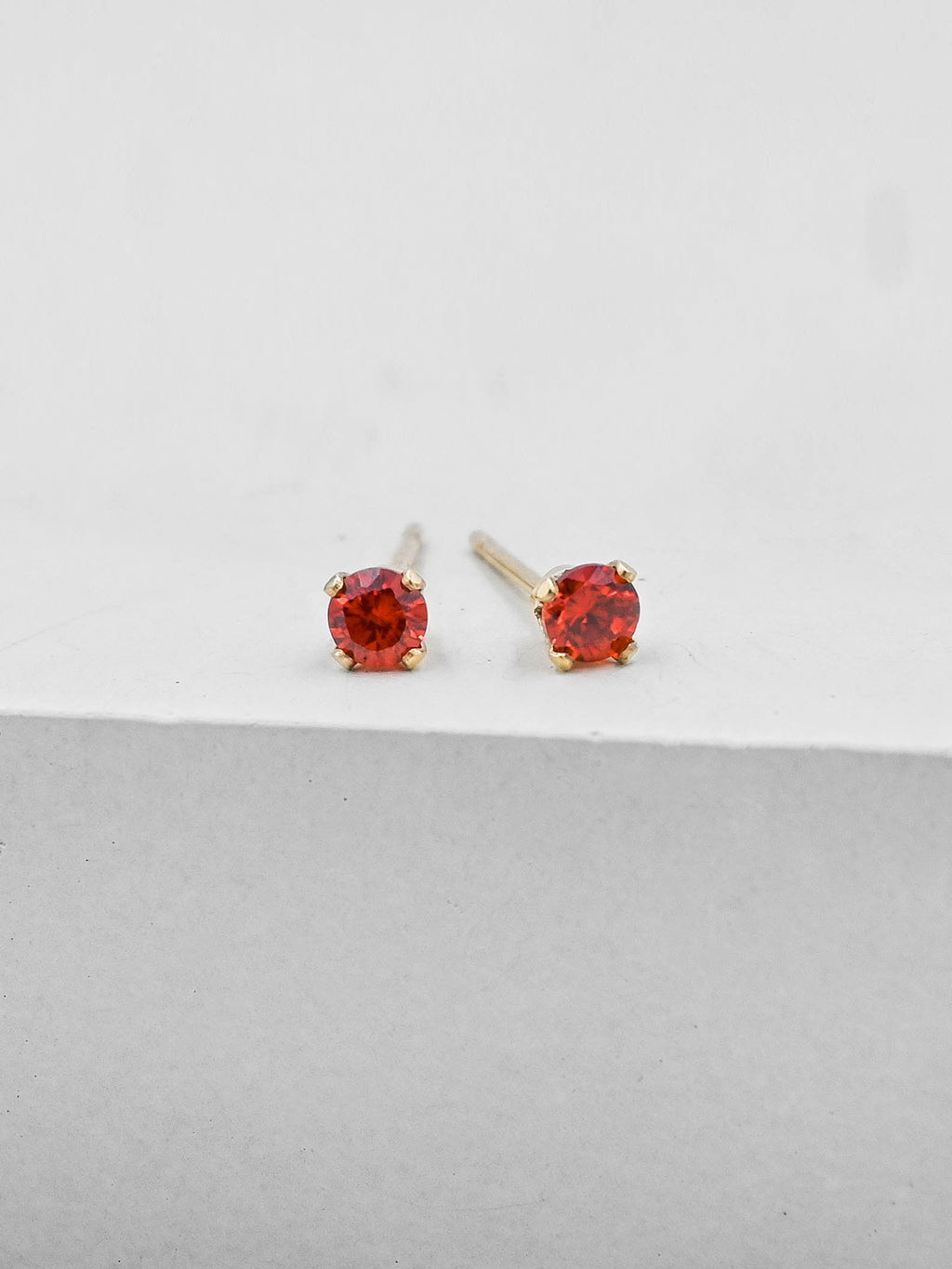 Red Round CZ Gold Plated Solitaire Stud Earrings by The Faint Hearted Jewelry