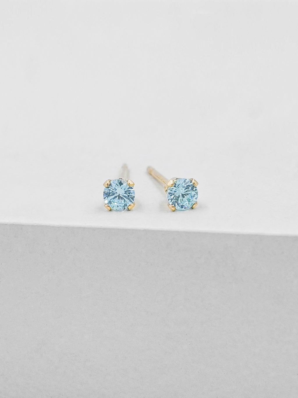 Aquamarine Round CZ Gold Plated Solitaire Stud Earrings by The Faint Hearted Jewelry