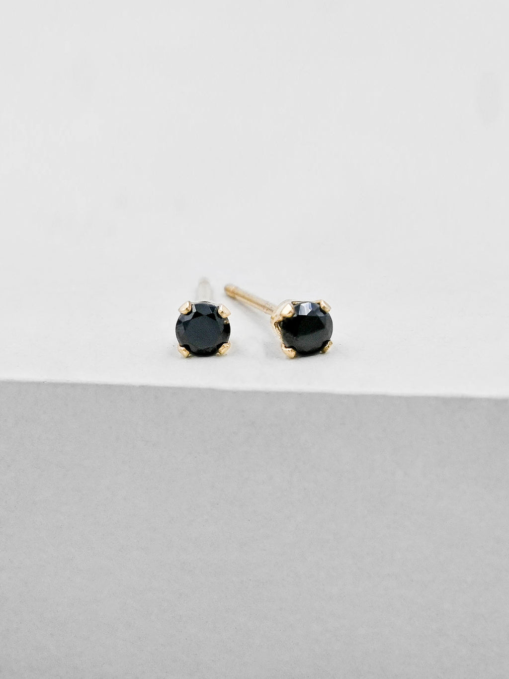 Black Round CZ Solitaire Gold Plated Solitaire Stud Earrings by The Faint Hearted Jewelry