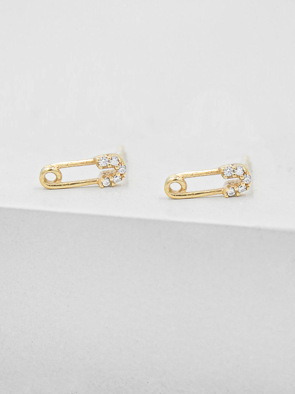 Gold Plated Brass Safety Pin design with Cubic Zirconia CZ Stones Stud Earrings by The Faint hearted Jewelry