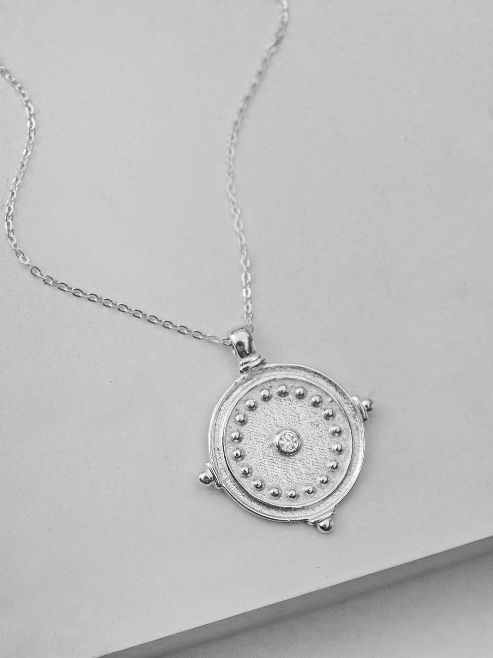 Silver Antique Coin Necklace by The Faint Hearted Jewelry