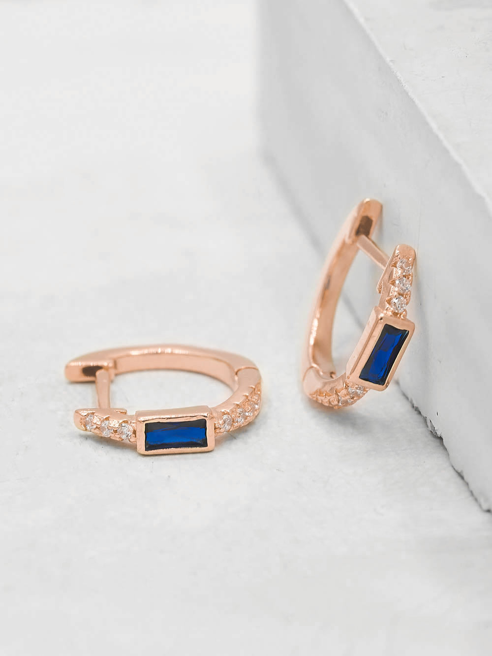 Rose gold plated Blue sapphire baguette Huggie Earrings by The Faint Hearted Jewelry