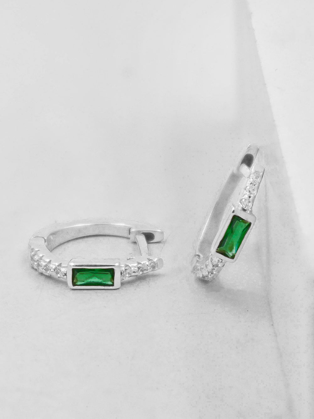 Rhodium Plated Emerald Green CZ baguette Huggies Earrings by The Faint Hearted Jewelry