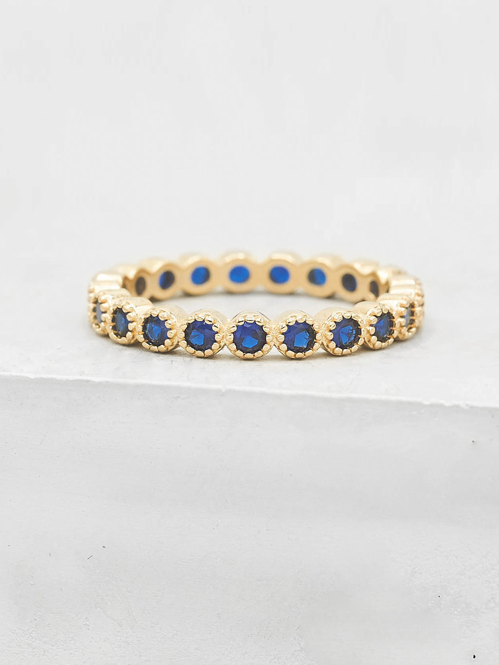 Bezel Set Eternity Ring with Round Blue Sapphire CZ by The Faint Hearted Jewelry
