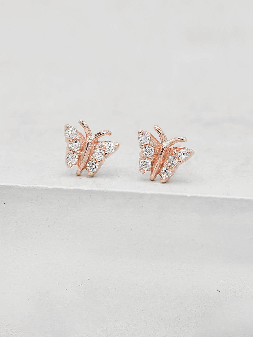 Rose Gold Plated Tiny butterfly with white CZ cubic Zirconia Dainty Stud Earrings by The Faint Hearted jewelry