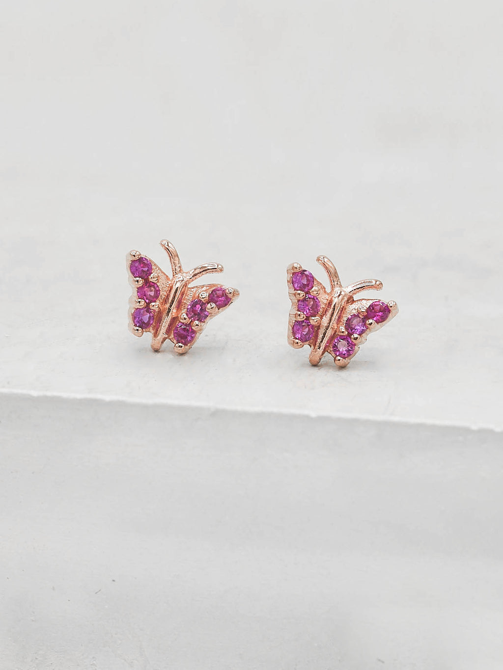 Rose Gold Plated Tiny butterfly with Pink CZ cubic Zirconia Dainty Stud Earrings by The Faint Hearted jewelry