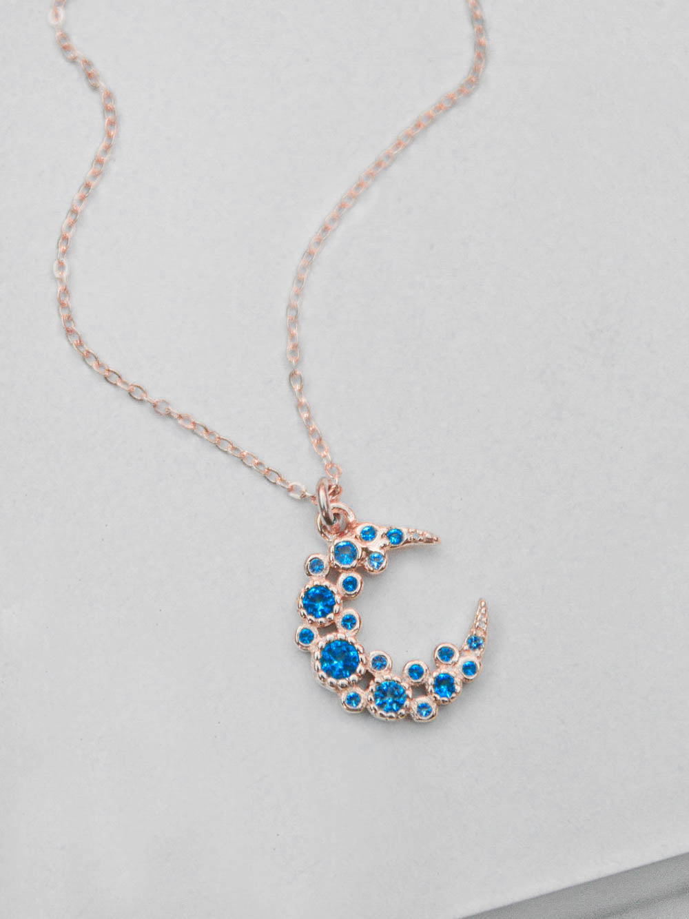 Blue Cluster Moon CZ Charm Rose Gold Necklace  by The Faint Hearted Jewelry