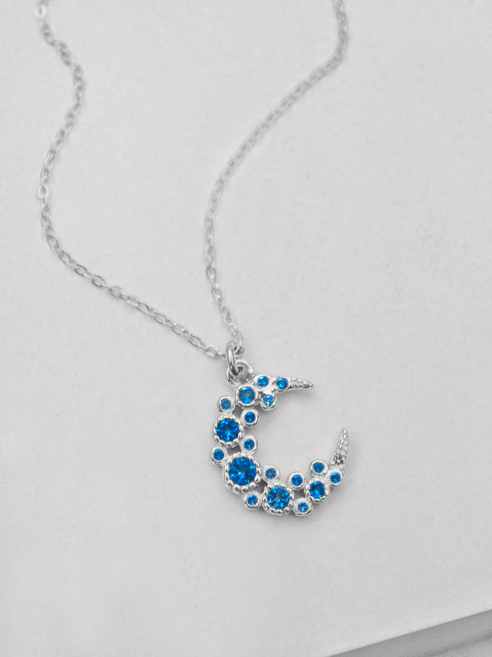 Blue Cluster Moon CZ Charm Silver Necklace  by The Faint Hearted Jewelry