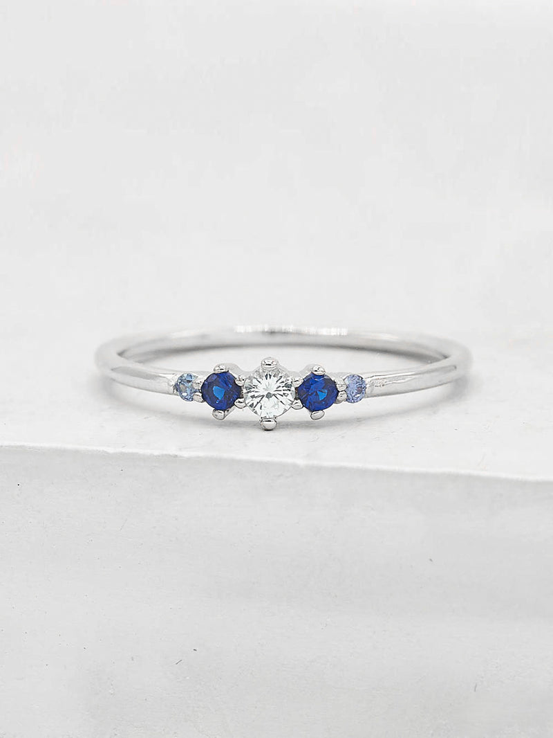 Rhodium Plated Tiara Style CZ Blue Stones Dainty Stacking Ring by The Faint Hearted Jewelry