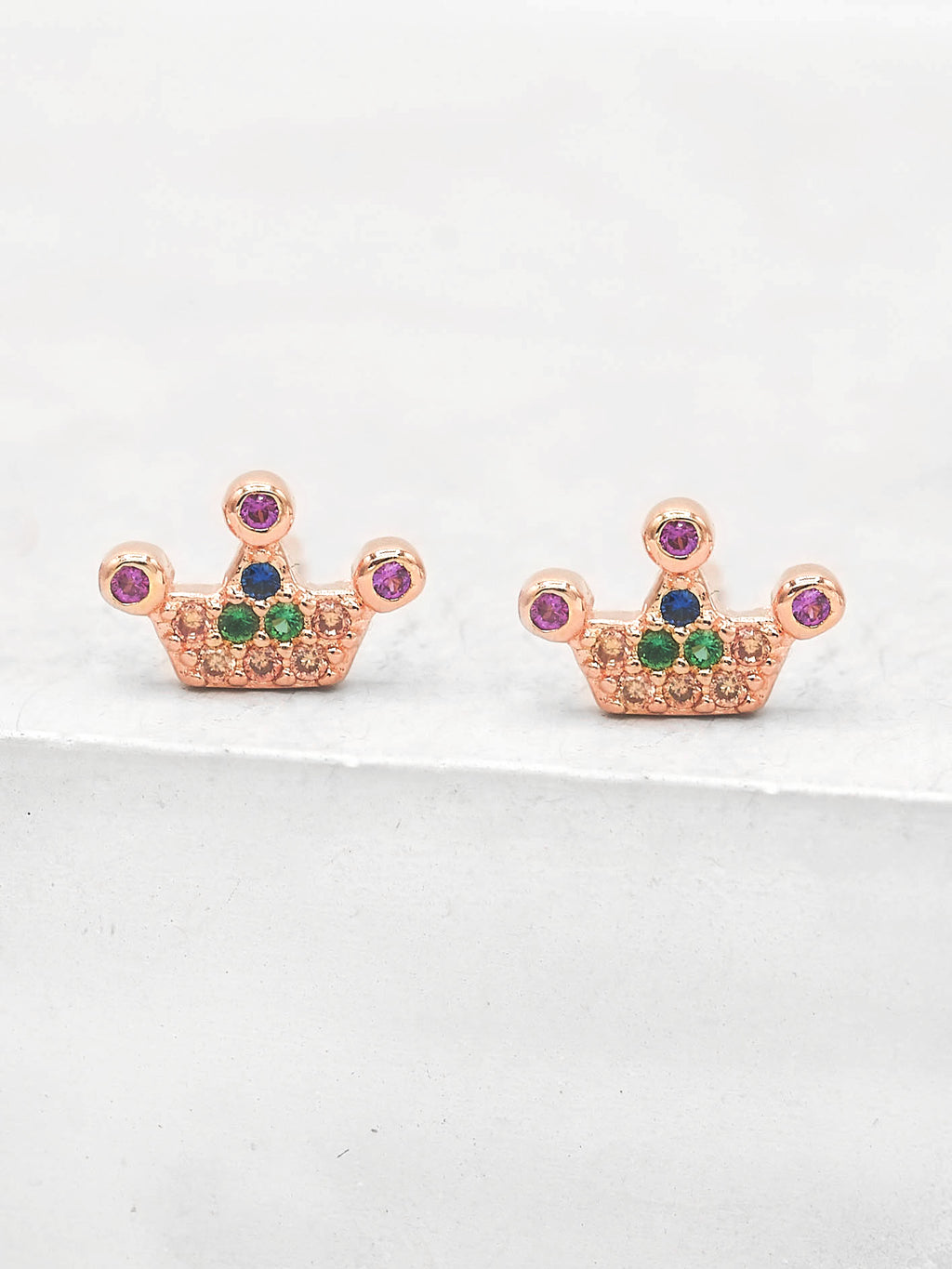 Rose Gold plated crown design with Round Rainbow CZ stones Crown design Stud Earrings by The Faint Hearted Jewelry