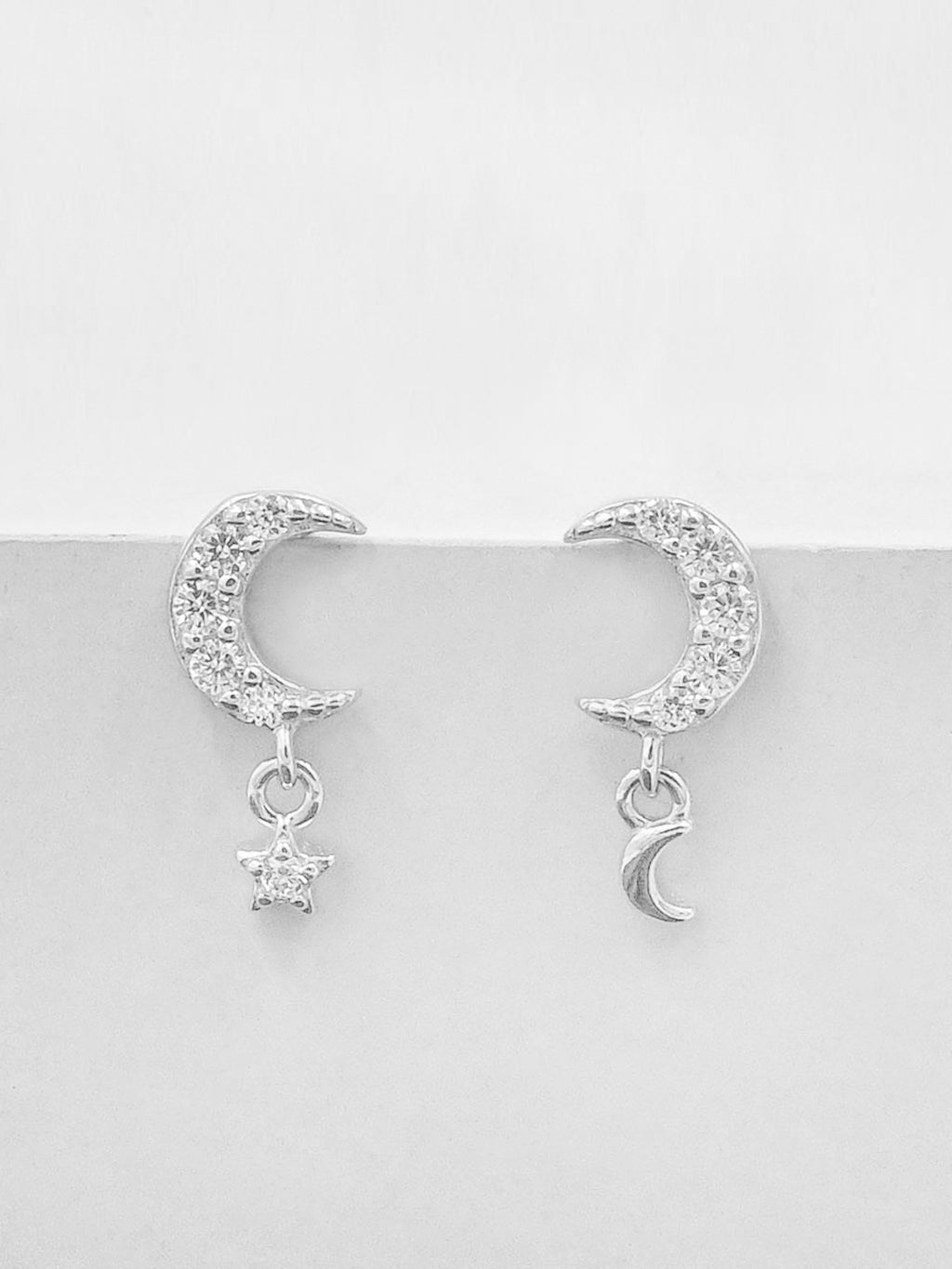Silver Minimalistic Dangle Moon and Star CZ Dainty Earrings by The Faint hearted Jewelry