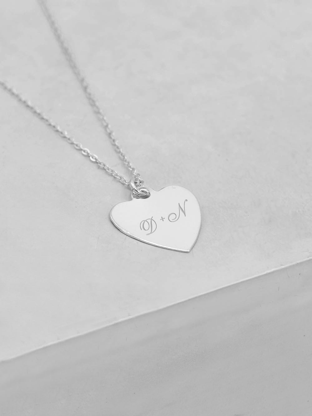 Heart Engraved Silver Necklace by The Faint Hearted Jewelry