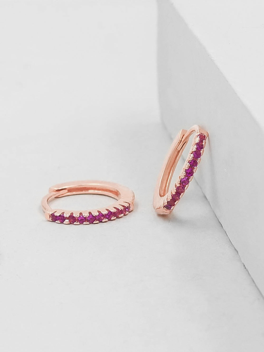Super Dainty Hoop Huggie Earrings with Pink Ruby Tiny Round Cubic Zirconia by The Faint Hearted Jewelry
