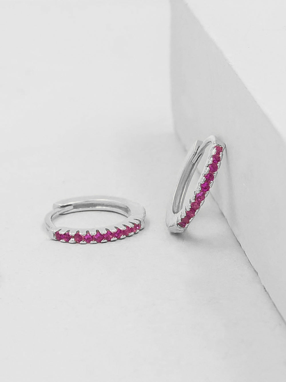 Rhodium Plated Super Dainty Hoop Huggie Earrings with Pink Ruby Tiny Round Cubic Zirconia by The Faint Hearted Jewelry