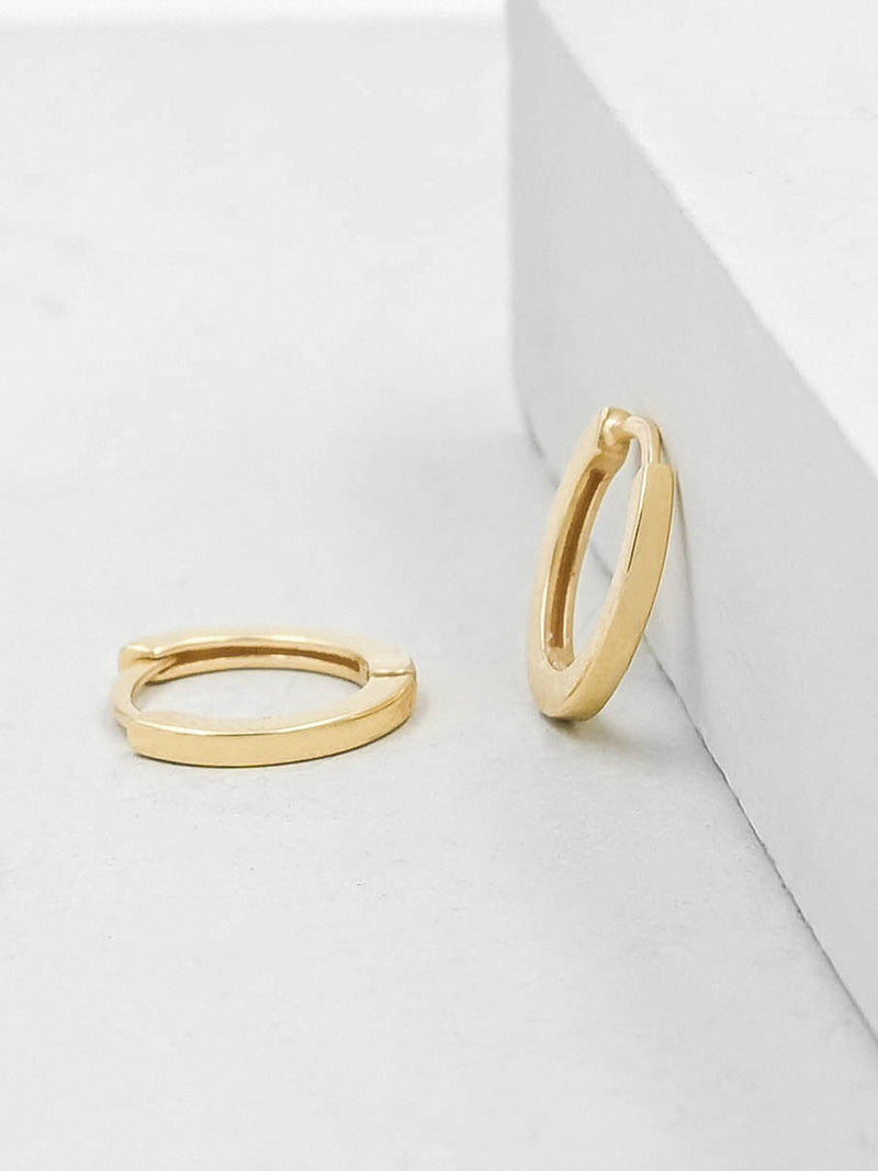 Gold Super Dainty Huggie Hoop earrrings by The Faint hearted Jewelry