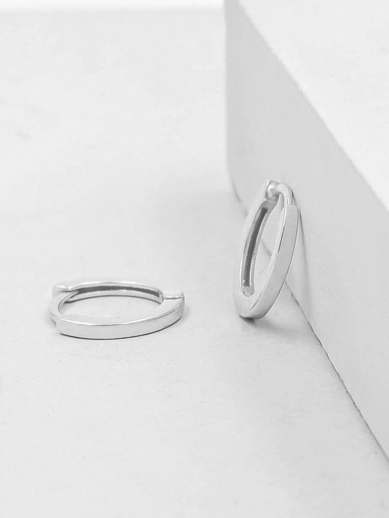 Rhodium Plated Super Dainty Huggie Hoop earrrings by The Faint hearted Jewelry