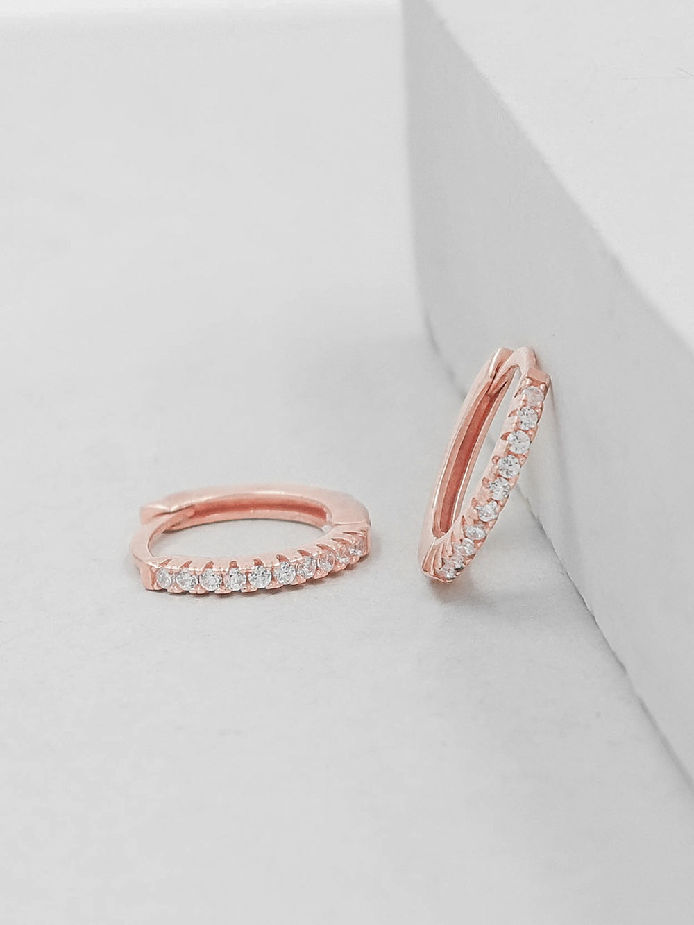 Rose Gold Plated Super Dainty Hoop Huggie Earrings with Tiny Round Cubic Zirconia by The Faint Hearted Jewelry