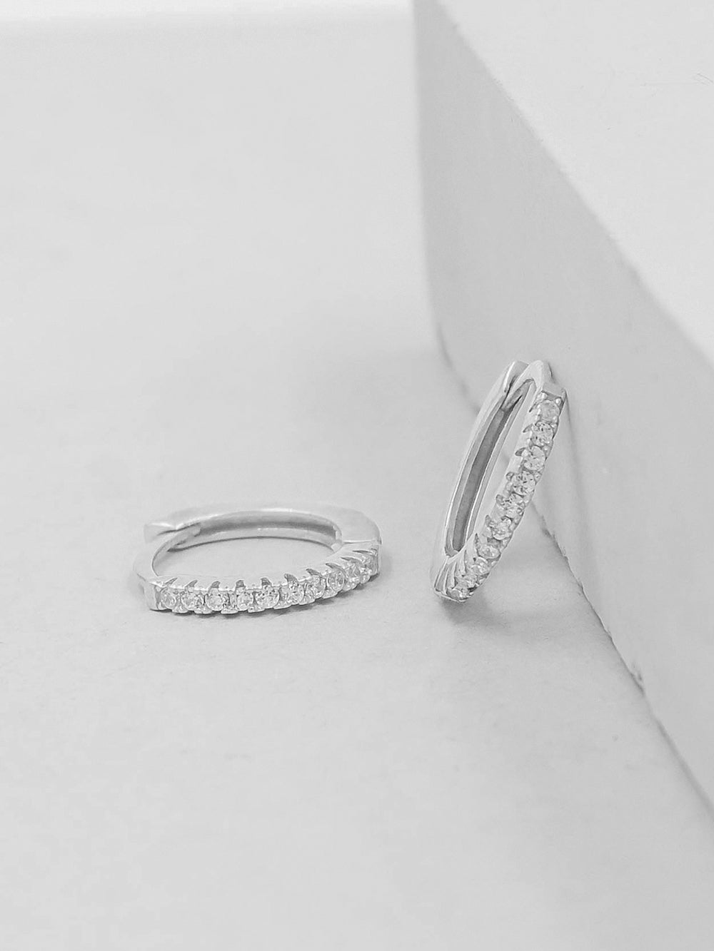 Silver Super Dainty Hoop Huggie Earrings with Tiny Round Cubic Zirconia by The Faint Hearted Jewelry