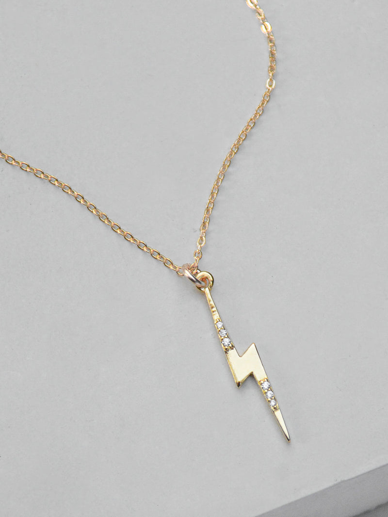 Gold Lightning Bolt Charm  Necklace by The Faint Hearted Jewelry