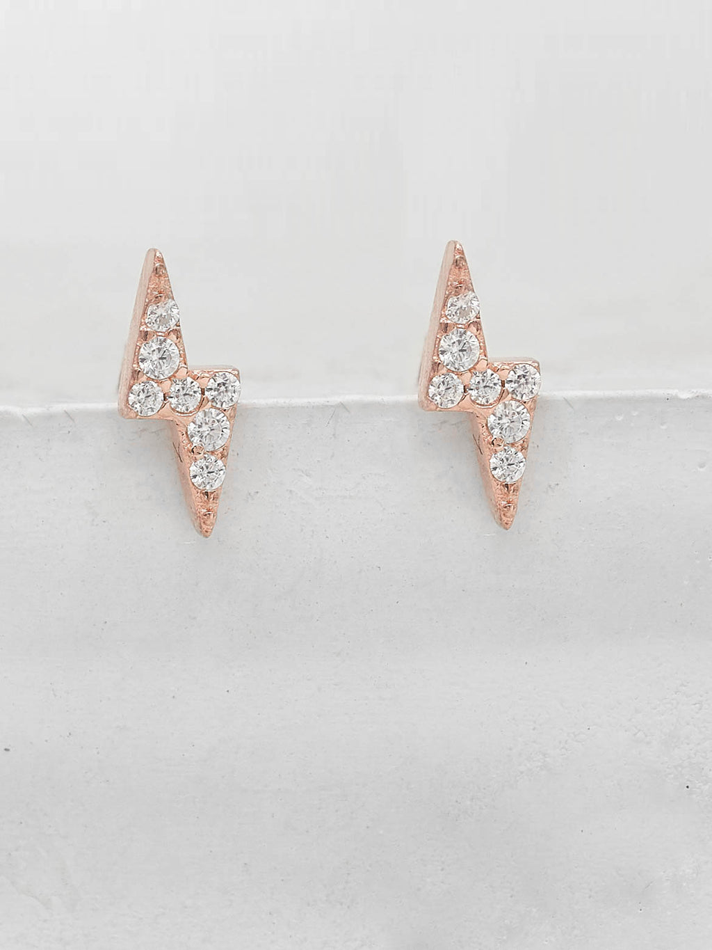 Rose gold Plated Tiny Lightning Bolt design with White Round CZ Cubic Zirconia Stud Earrings by The Faint Hearted Jewelry
