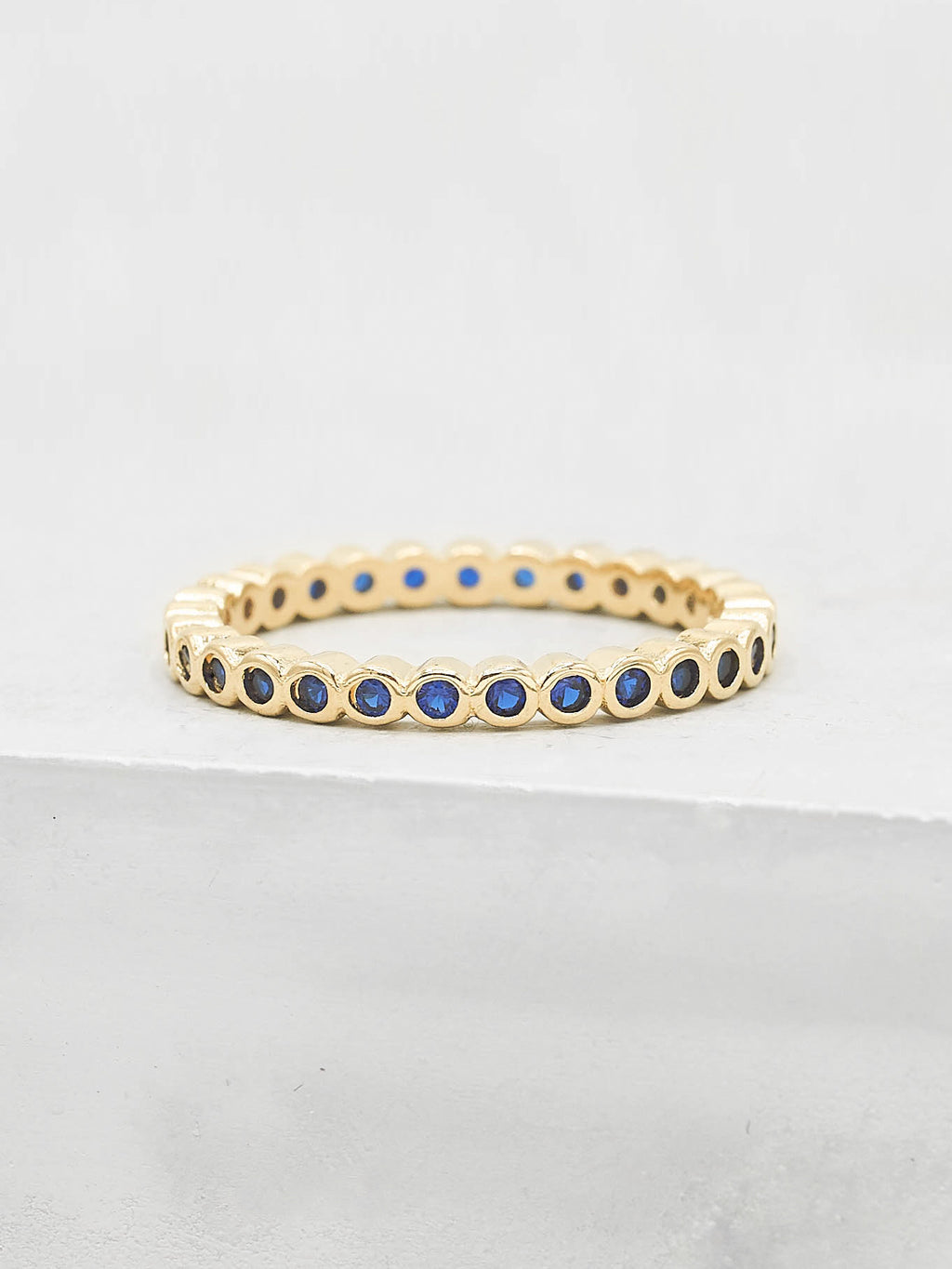 Mini Bezel Eternity Ring - Gold + Sapphire