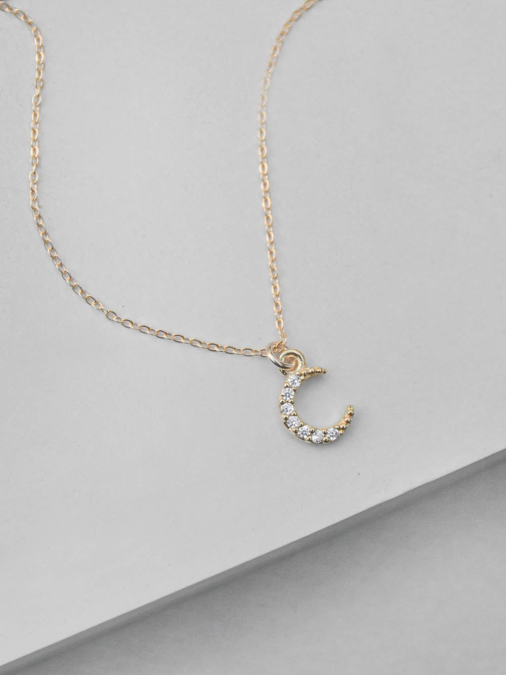 Mini Crescent CZ Charm Gold  Necklace by The Faint Hearted Jewelry