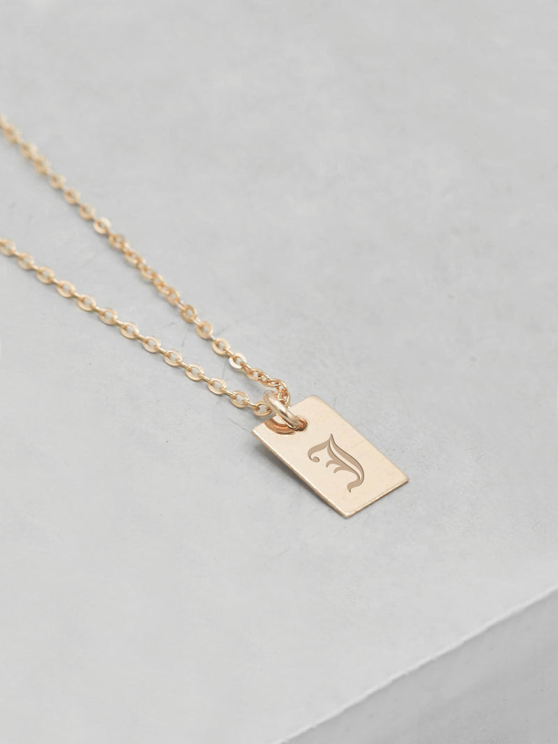 Engraved Mini Tag Gold Necklace by The Faint Hearted Jewelry