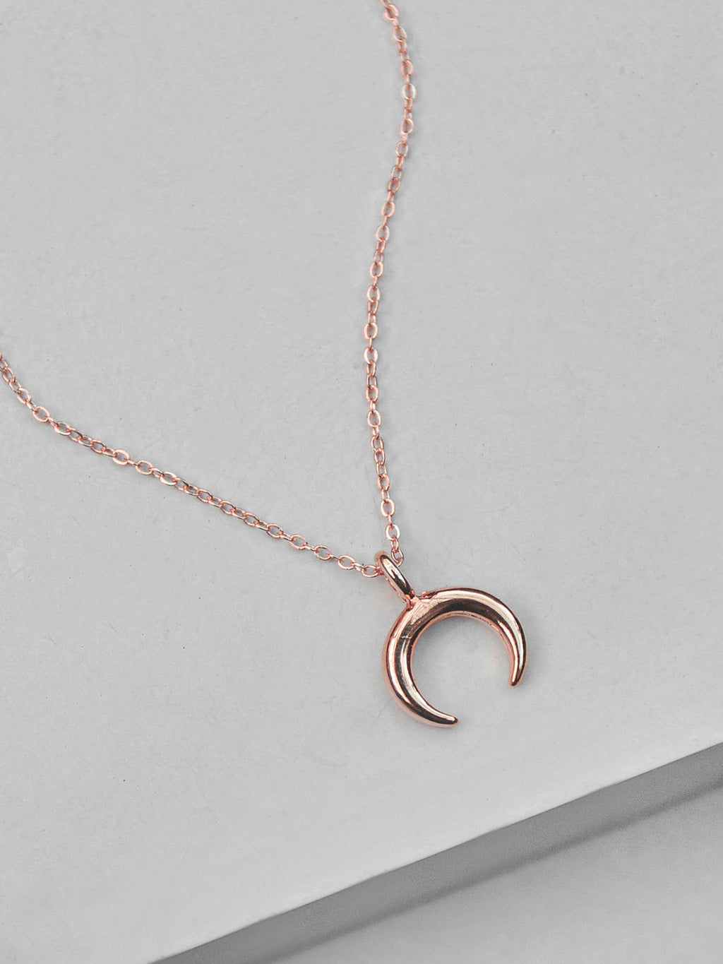Small Rose Gold Moon Charm Necklace by The Faint Hearted Jewelry
