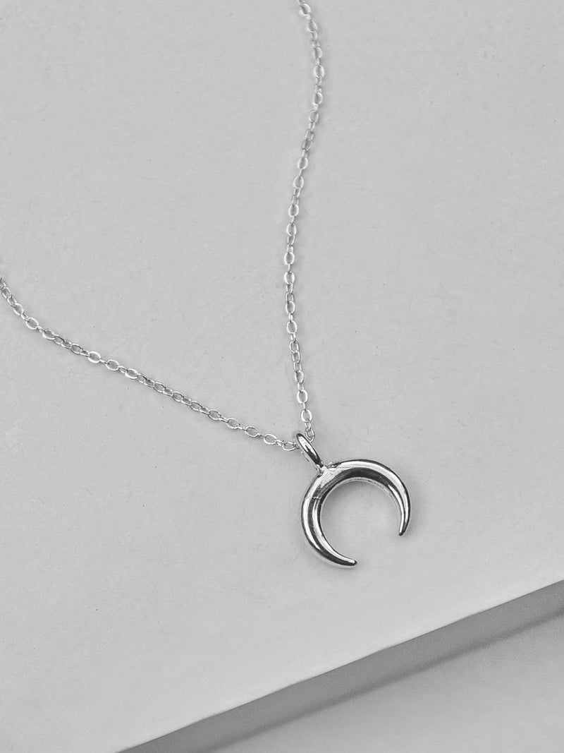 Sterling Silver Small Moon Necklace by The Faint Hearted Jewelry