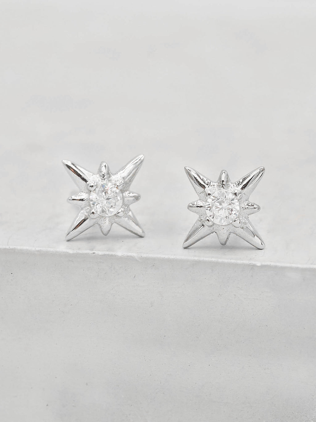 Silver North Star Design Stud with Round White CZ Minimalist Style Dainty Stud Earrings by The Faint hearted jewelry