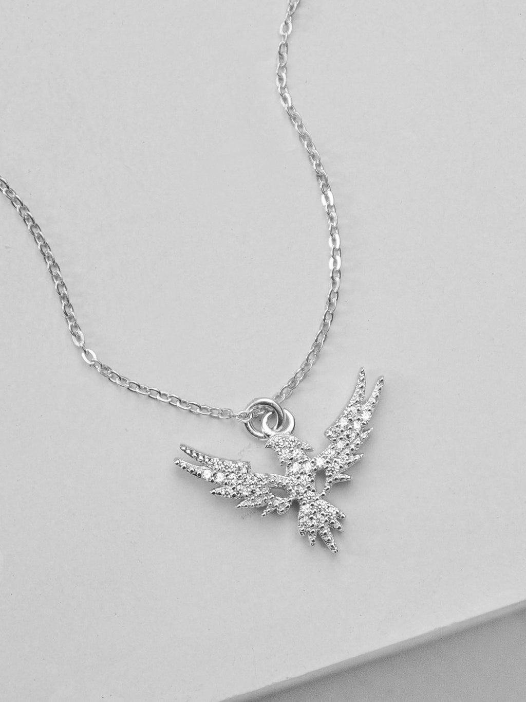 Sterling Silver Phoenix Charm Necklace by The Faint Hearted Jewelry