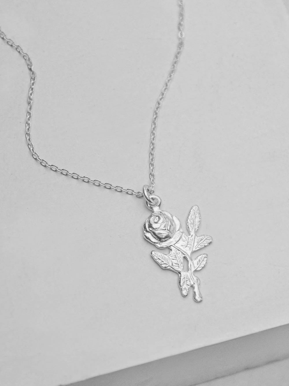 Sterling Silver Rose Charm Necklace by The Faint Hearted Jewelry